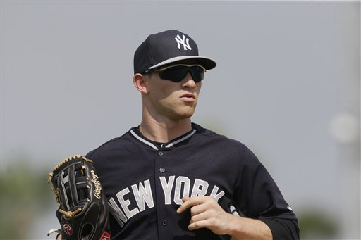 New York Yankees center fielder Slade Heathcott runs to the dugout during the seventh inning of a spring training exhibition baseball game against the Detroit Tigers in Lakeland, Fla., Friday, March 20, 2015. (AP Photo/Carlos Osorio)