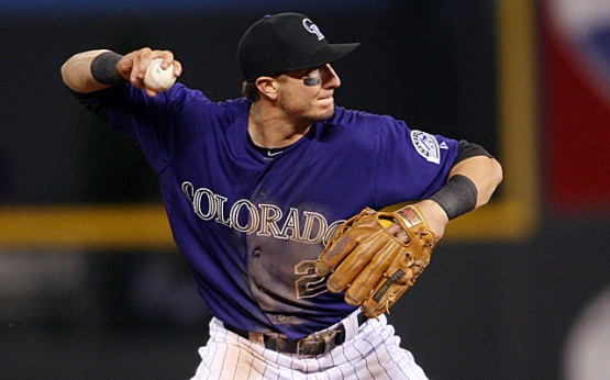 May 1, 2012; Denver, CO, USA; Colorado Rockies shortstop Troy Tulowitzki (2) fields a ground ball during the seventh inning against the Los Angeles Dodgers at Coors Field.  Mandatory Credit: Chris Humphreys-USA TODAY Sports