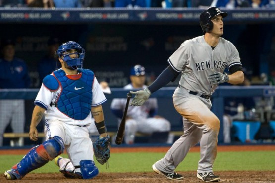 TORONTO, CANADA SEPTEMBER 22:  Greg Bird #31 of the New York Yankees hits a three run home run scoring Brian McCann and  Slade Heathcott putting the Yankees ahead 6-3 during the game against the Toronto Blue Jays at the Rogers Center on Monday, September 22, 2015. (Photo by Anthony J Causi)