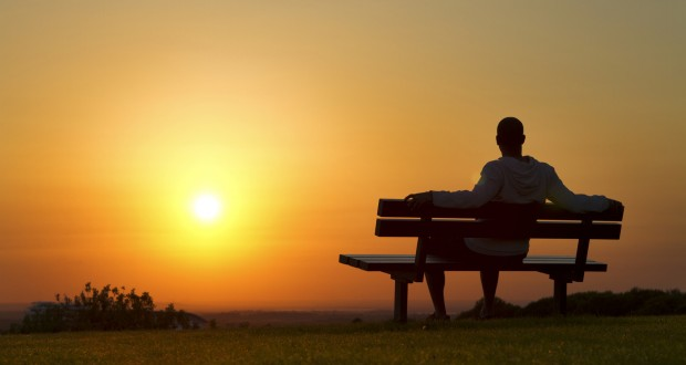 Man-Sitting-on-Bench-at-Sunset-620x330