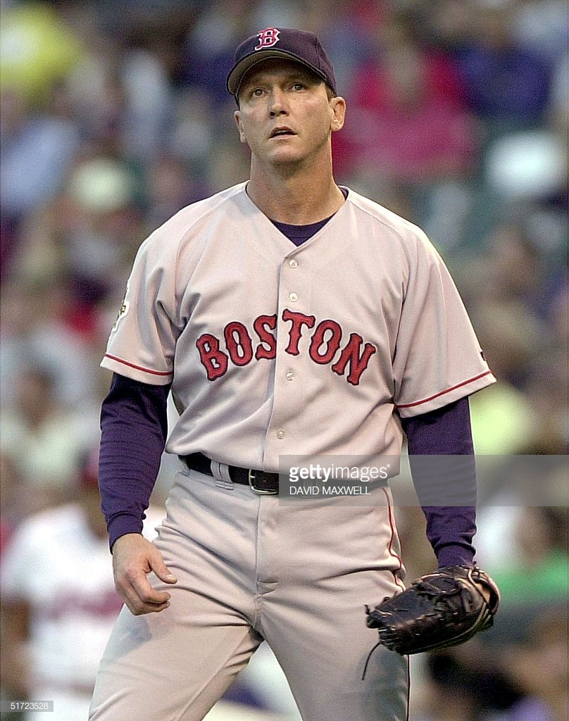 Boston Red Sox pitcher David Cone reacts after wal