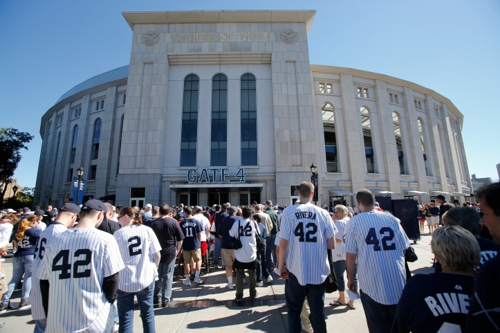 Fans wearing the number 42 of New York Yankees relief pitcher  Mariano Rivera line up to enter the stadium in MLB game in New York